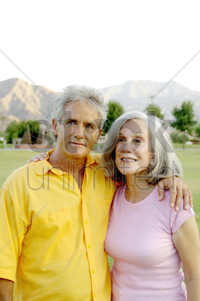 old couple posing for the camera stock photo