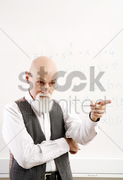 old professor pointing at his student stock photo