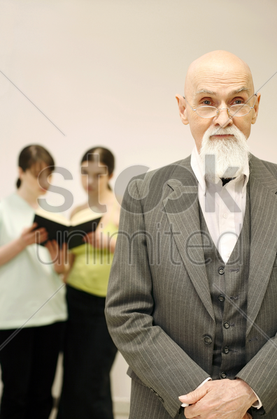 old professor with his students having discussion on the background stock photo