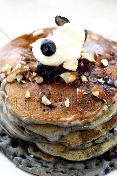 pancake with almonds and blueberries stock photo