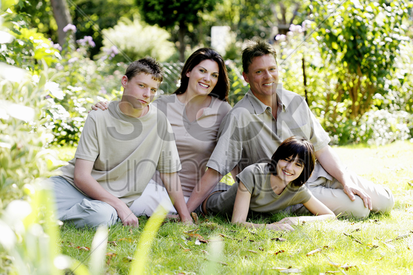 parents and children posing for the camera stock photo