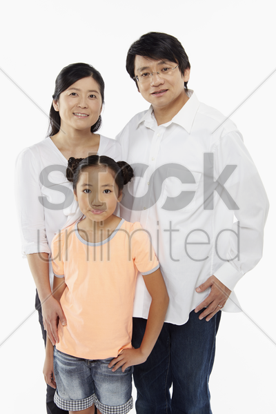 parents and daughter smiling at the camera stock photo