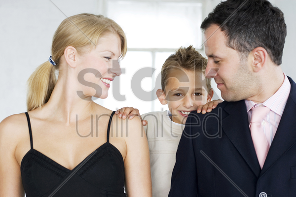 parents and son in formal wear stock photo