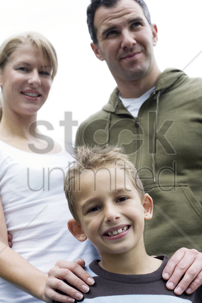 parents and son posing for the camera stock photo