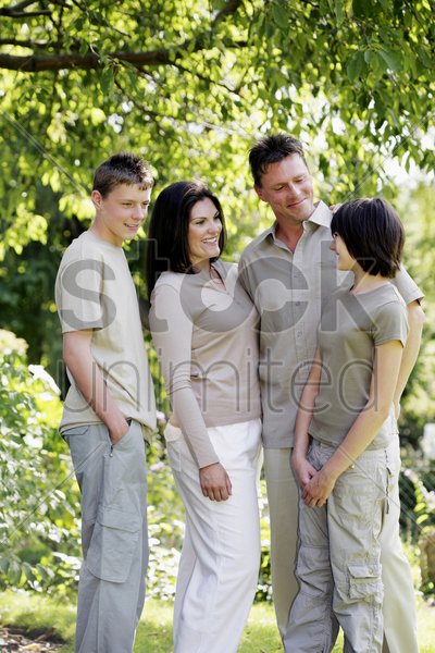 parents talking to their daughter stock photo