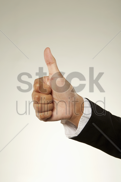 person giving thumbs up stock photo