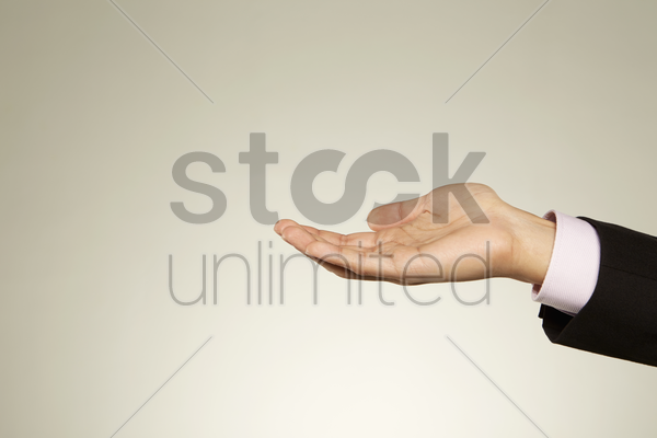 person holding out his palm stock photo