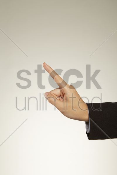 person holding out index finger stock photo