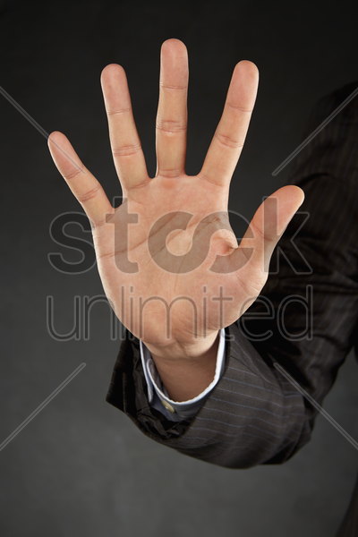 person holding out palm stock photo