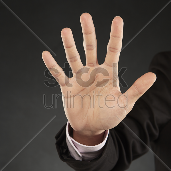 person reaching out palm stock photo