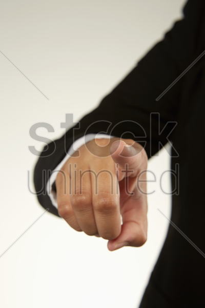 person showing pointing gesture stock photo