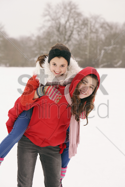 playful girls in winter stock photo
