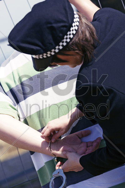police officer arresting a man stock photo