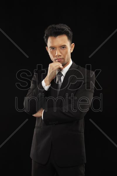 portrait of a businessman contemplating stock photo