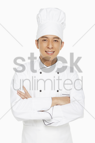 portrait of a cheerful chef stock photo