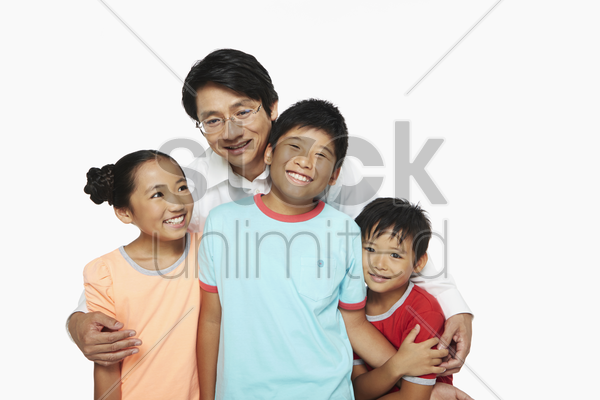 portrait of a cheerful father with his children stock photo