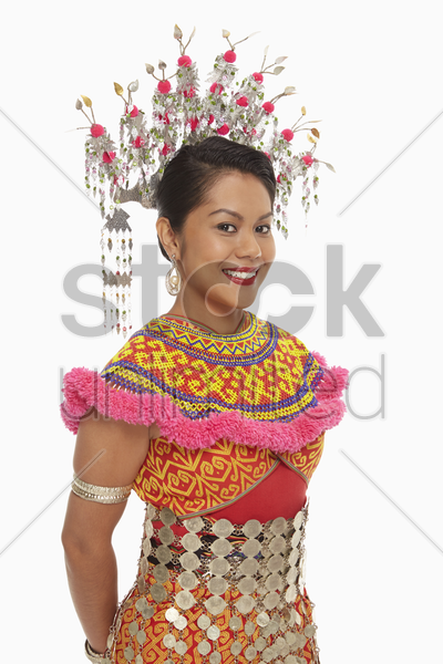 portrait of a cheerful woman in an iban traditional clothing stock photo