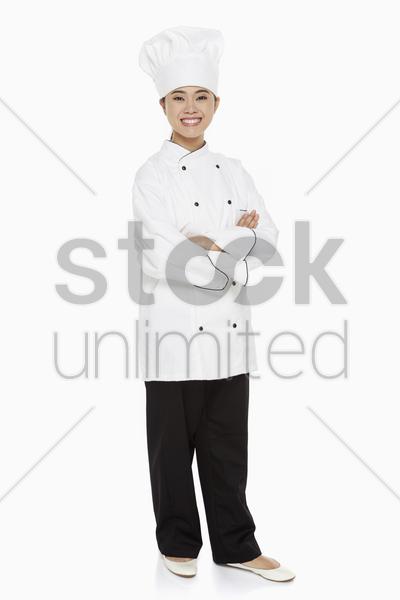 portrait of a female chef smiling stock photo