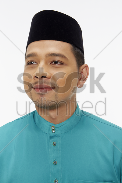 portrait of a man in traditional clothing smiling stock photo