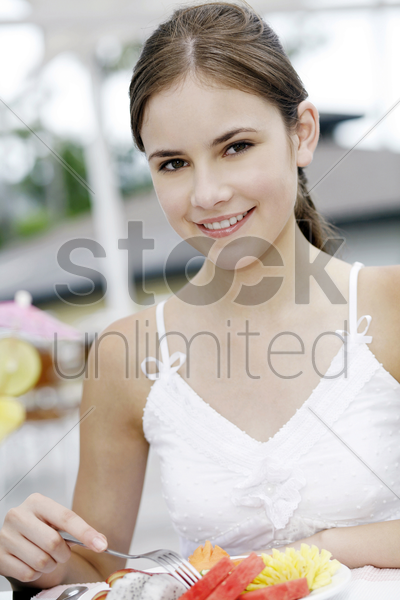portrait of a teen girl smiling stock photo