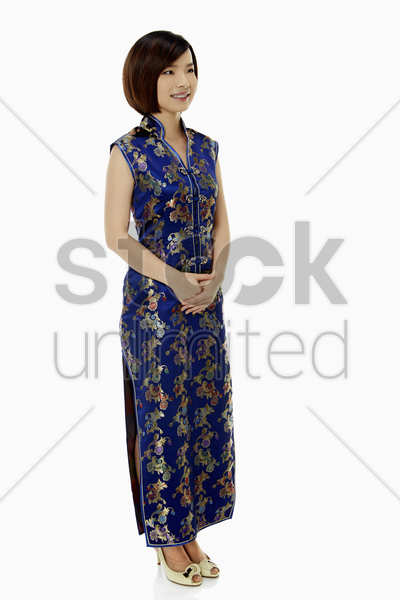 portrait of a woman in traditional clothing smiling stock photo