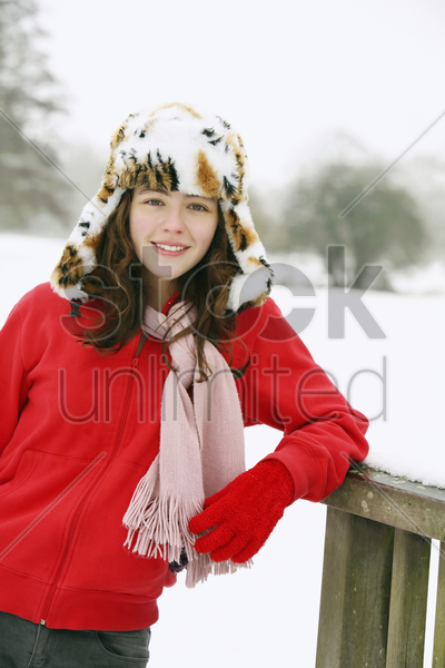 portrait of girl smiling, wearing a tiger hat stock photo