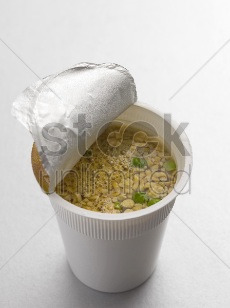 preparation of cup noodles stock photo