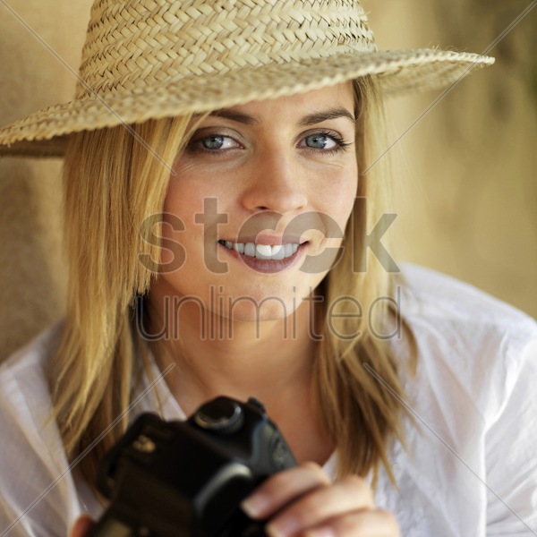 professional female photographer in straw hat stock photo