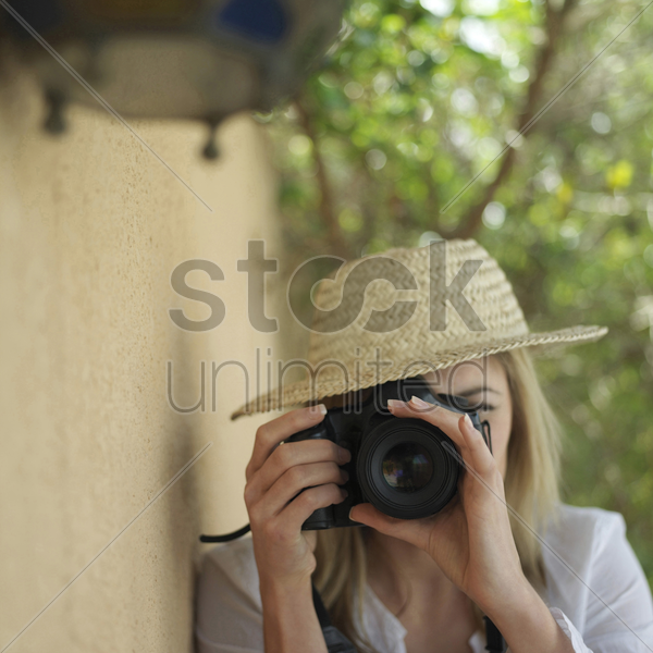 professional female photographer taking picture stock photo