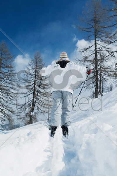 rear view of woman skiing stock photo