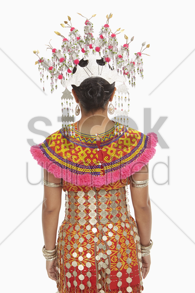 rear view shot of a woman in an iban traditional clothing stock photo
