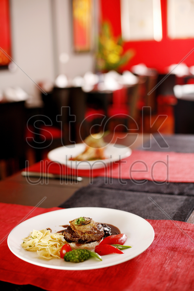 rib of beef with farfalle and vegetables stock photo