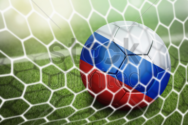 russia soccer ball in goal net stock photo