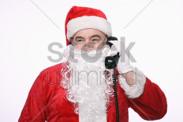 santa claus talking on the phone stock photo