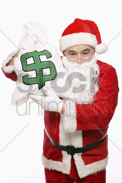 santa claus with a bag of money stock photo