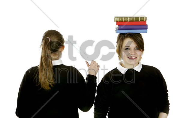 school girls posing for the camera stock photo