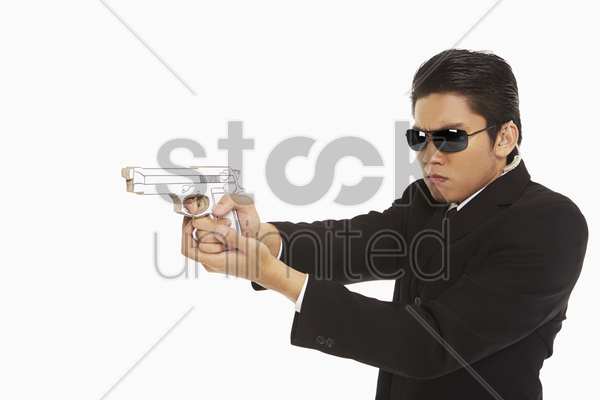 security staff holding a gun, shooting stock photo