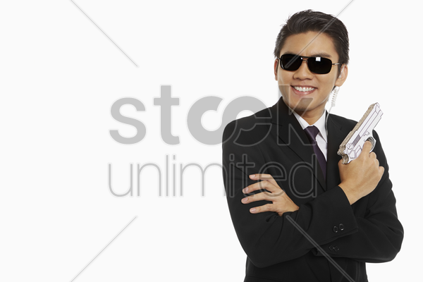 security staff holding a gun stock photo