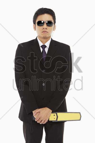 security staff with a metal detector stock photo