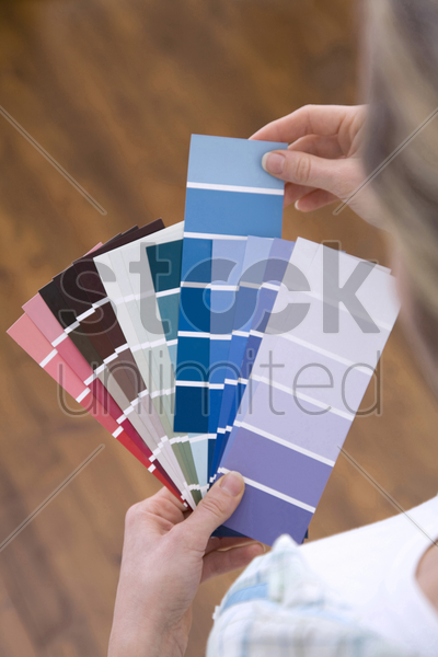 selecting paint colour for new home stock photo