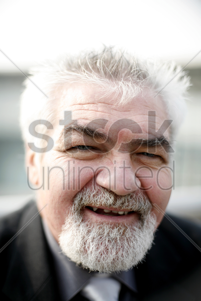 senior businessman smiling at the camera stock photo