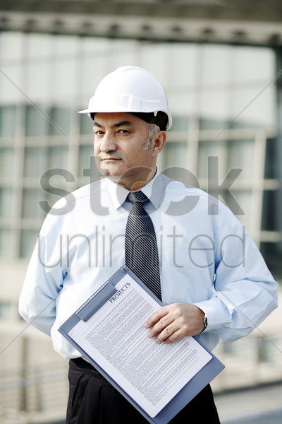 senior businessman wearing a safety helmet stock photo