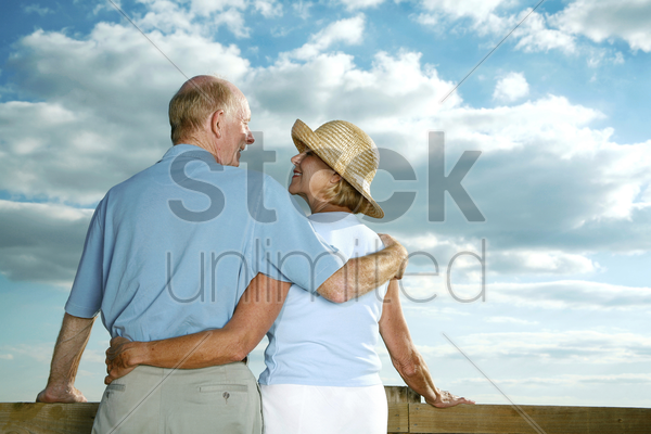 senior couple enjoying a beautiful day stock photo