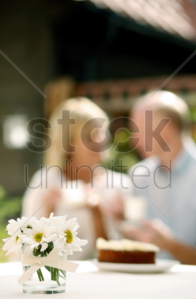 senior couple enjoying teatime together stock photo