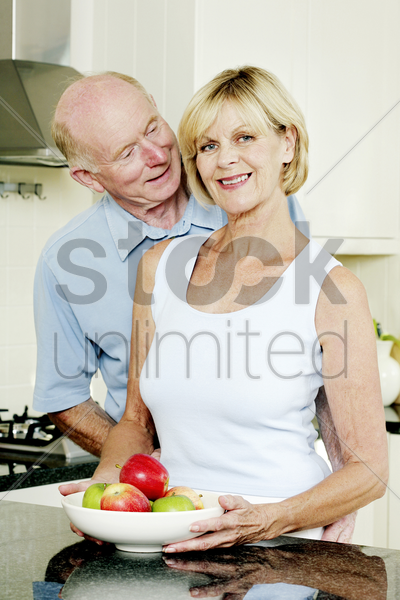 senior couple in the kitchen stock photo