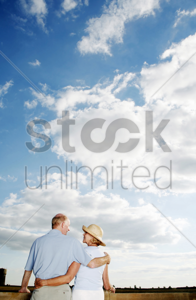 senior couple looking at each other stock photo