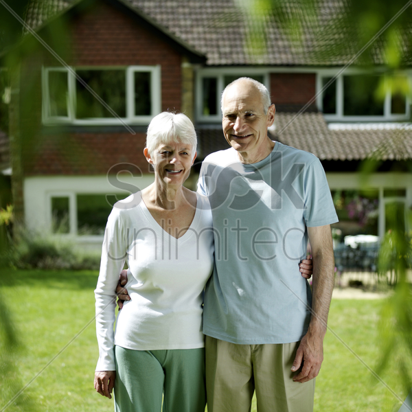 senior couple posing for the camera stock photo