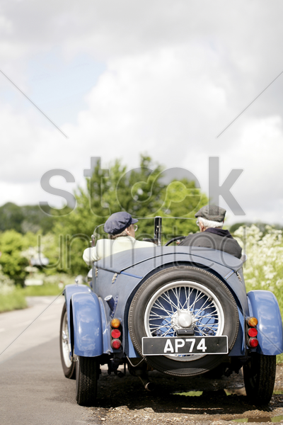senior couple traveling in the car together stock photo