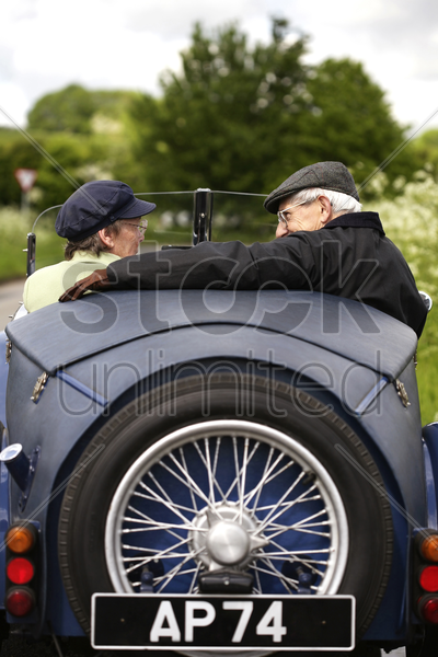 senior couple traveling in the car stock photo