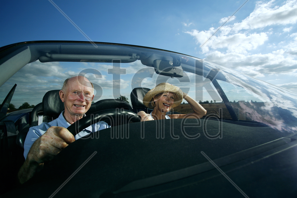 senior couple travelling together in the car stock photo